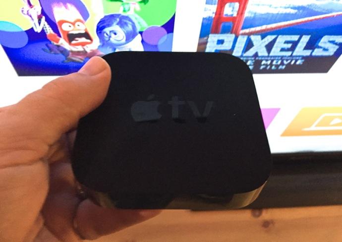 Apple TV in hand.jpg