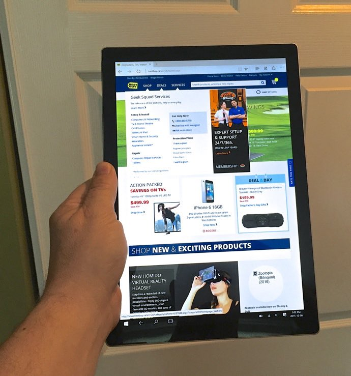 Surface Pro 4 in hand.jpg