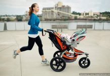 Woman pushing a stroller while going for a jog