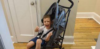 guzzie and guss lightweight stroller with child
