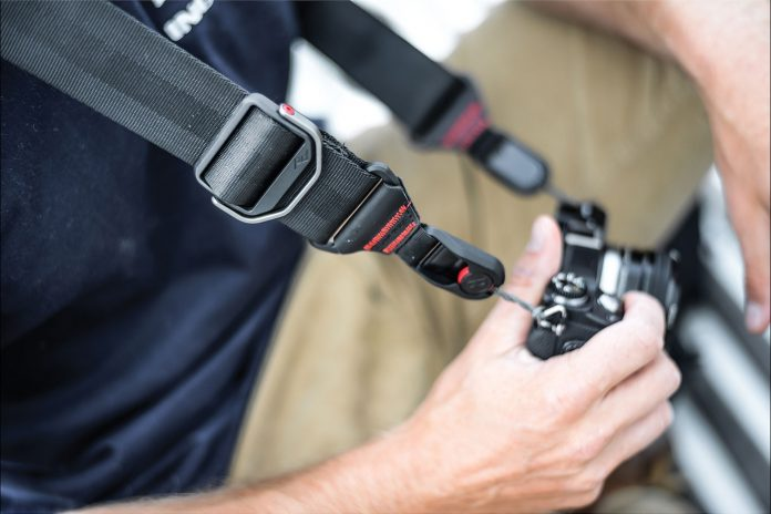Photographer using Peak Design Slide Camera Strap