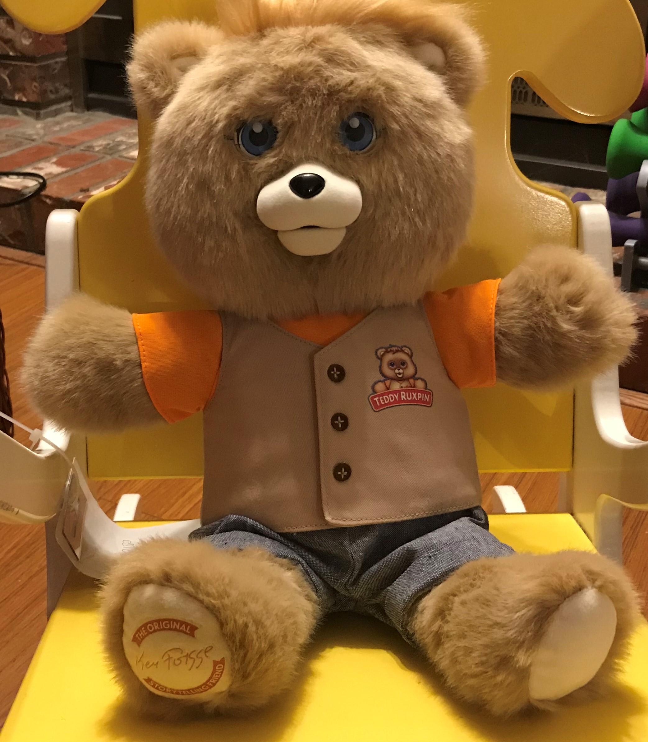 Teddy Ruxpin sitting in a chair