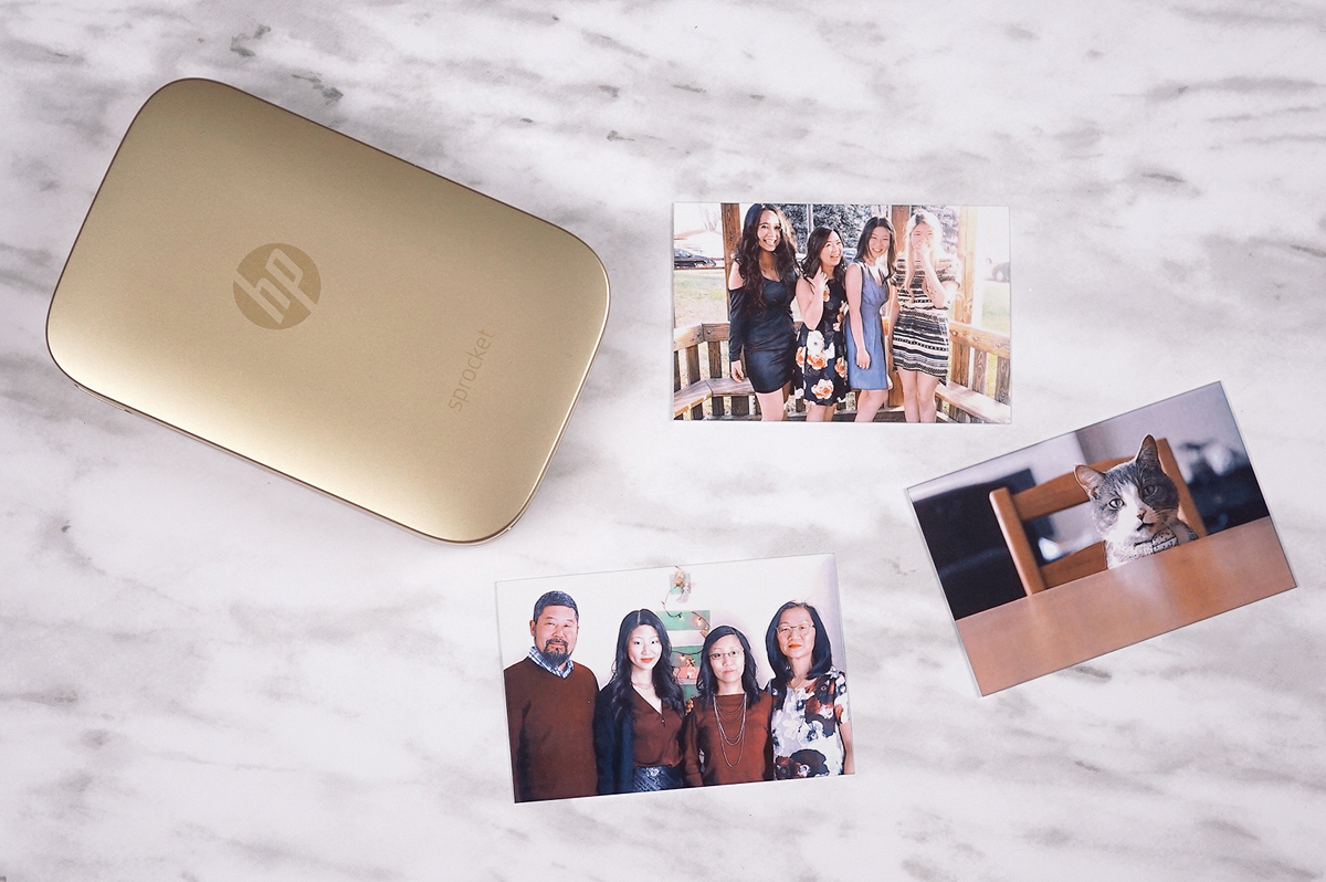 HP Sprocket printer with sample photos