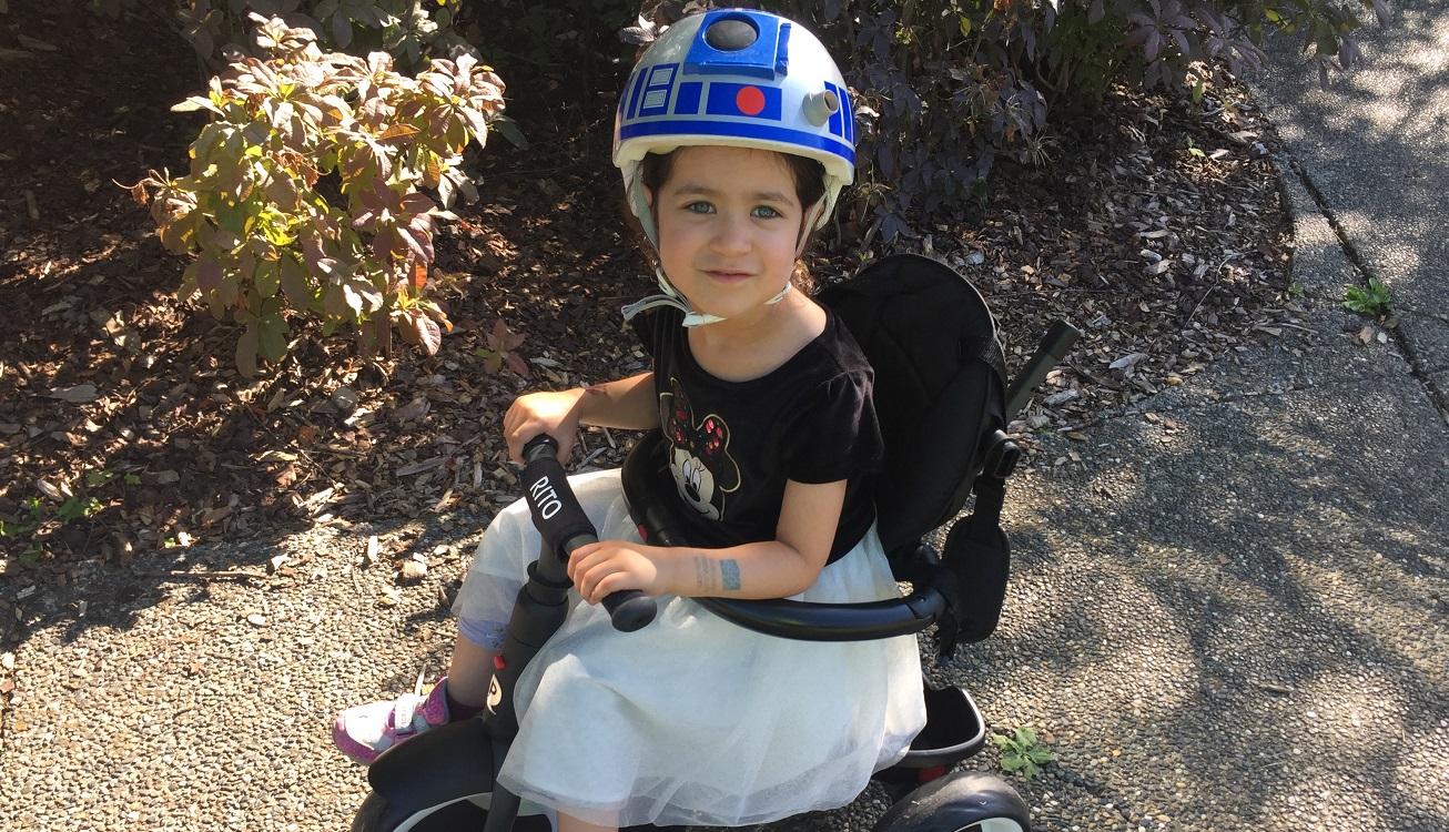 Child Riding Rito Folding Trike