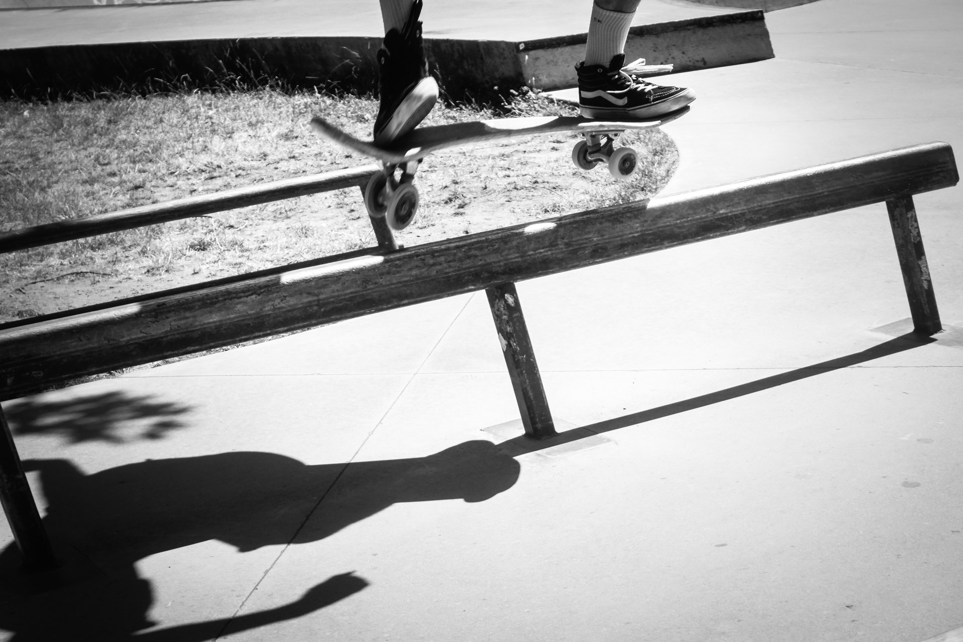 Photo of a skateboarder on a rial