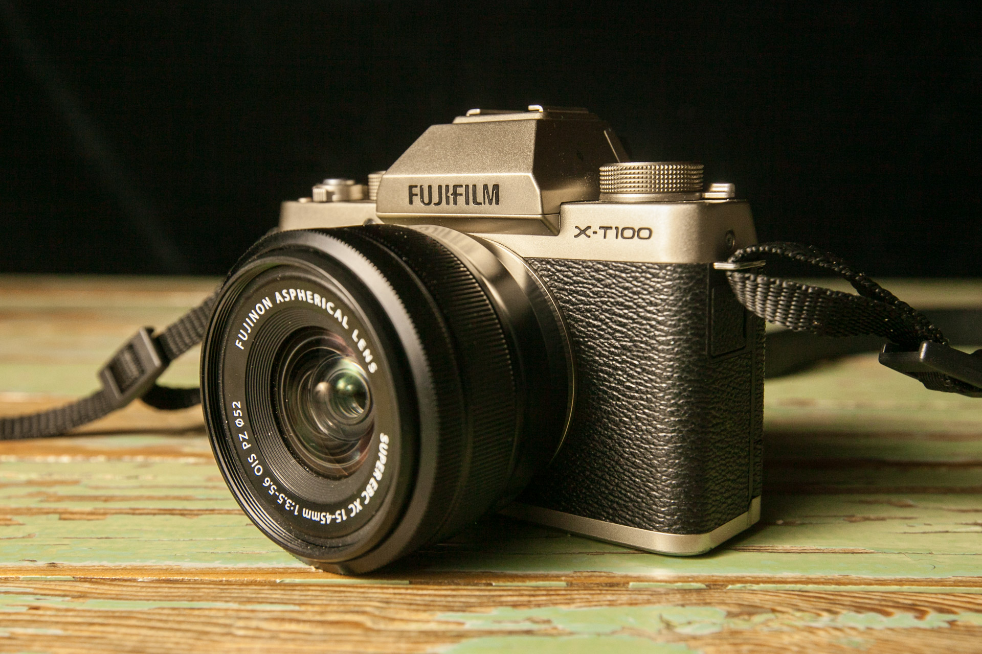 An image of the Fujifilm X-T100 sitting on a table