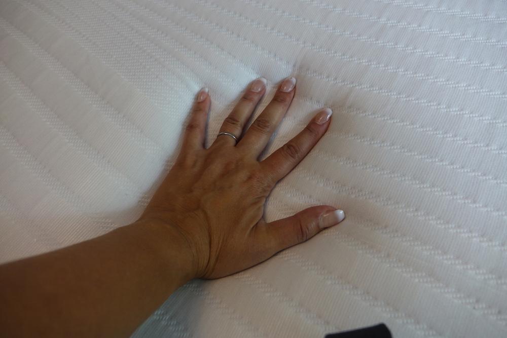 koala mattress firmness check with hand