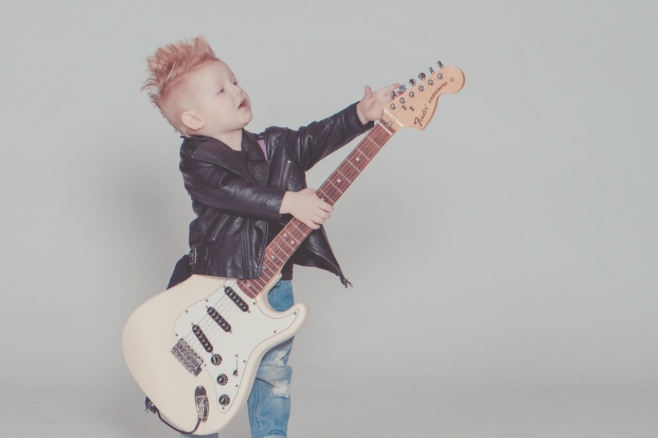 Child playing electric guitar