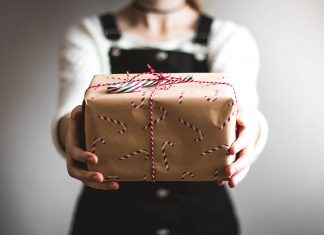 A photo of a person holding a Christmas gift