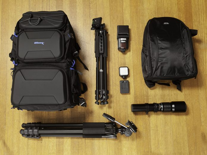 A photo of some Ultimaxx camera gear laid out on a wooden floor
