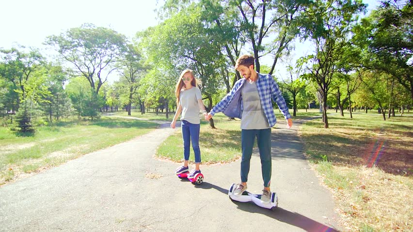 People riding hoverboard