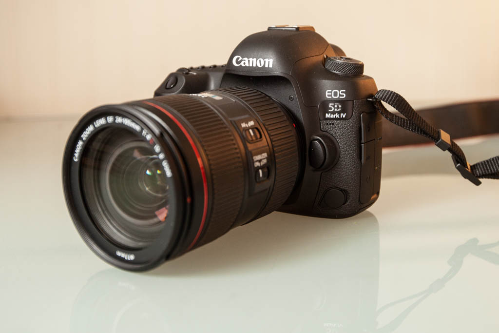 A photo of the Canon 5D MkIV DSLR camera sitting on a glass table