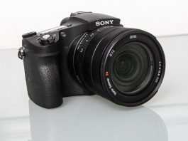 Photo of the Sony RX10 IV on a lgass table