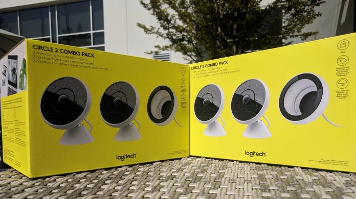 Two yellow Logitech Circle 2 boxes sitting on a table outdoors in the sun.