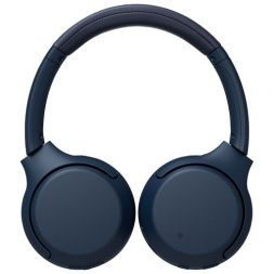 The blue Sony WH-XB700 headphones laid flat on a white background.