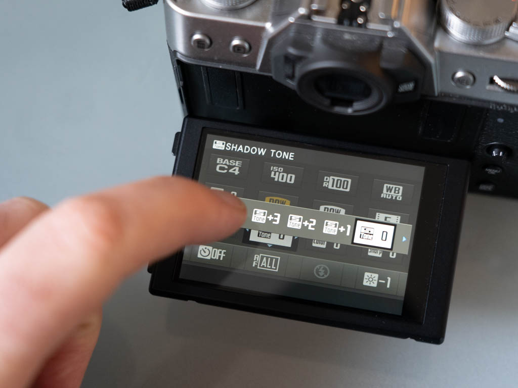 A photo of the Fujifilm X-T30 touchscreen in use