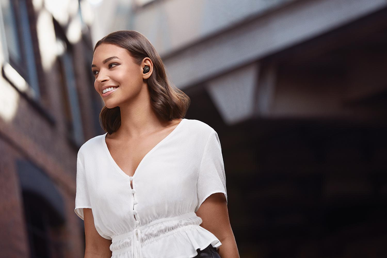image of woman wearing jabra elite 75t truly wireless headphones