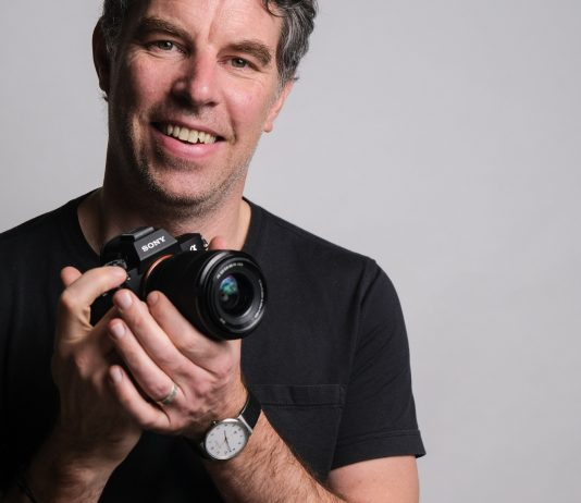 Photographer Justin Morrison holding the Sony a7 III mirrorless camera