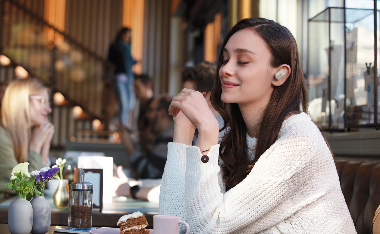 image of woman wearing truly wireless headphones
