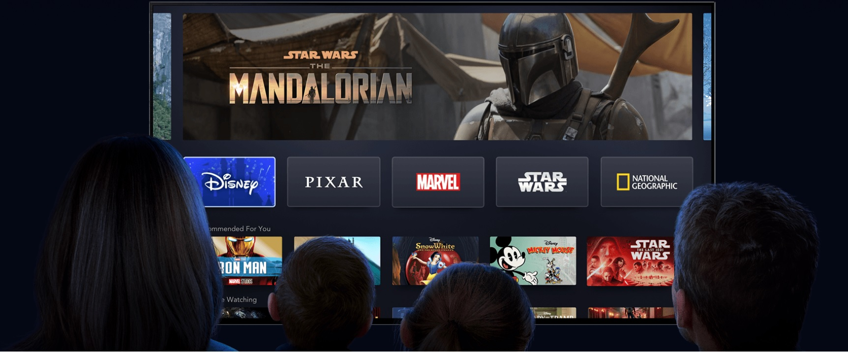 image of family watching disney+ with star wars the mandalorian on screen