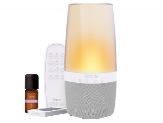 image of the iHome Zenergy Aromatherapy Bluetooth Speaker with remote control and bottle of lavender essential oil
