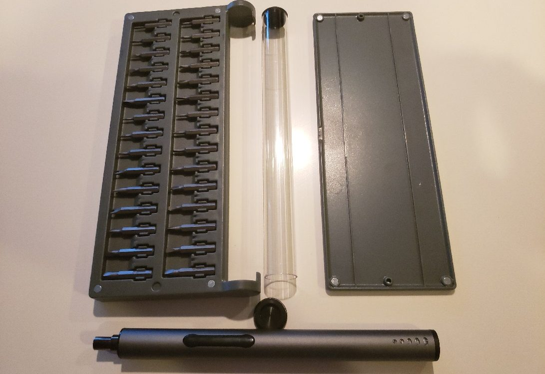 image of KONOS 55-in-1 set showing case, side panel, electric screwdriver, and storage tube