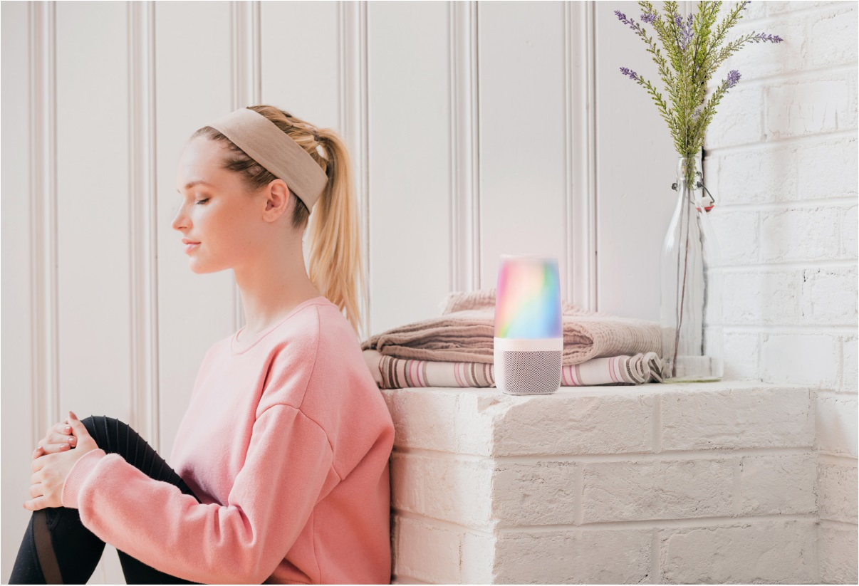 image of woman calmly relaxing with iHome Zenergy Aromatherapy Bluetooth Speaker