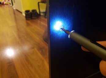 image of KONOS electric screwdriver from 55-in-1 set working on a cabinet with LED lighting the area