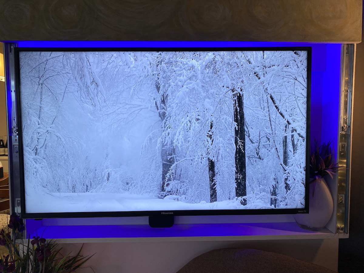 LIFX Z TV light strip shining a blue light behind tv