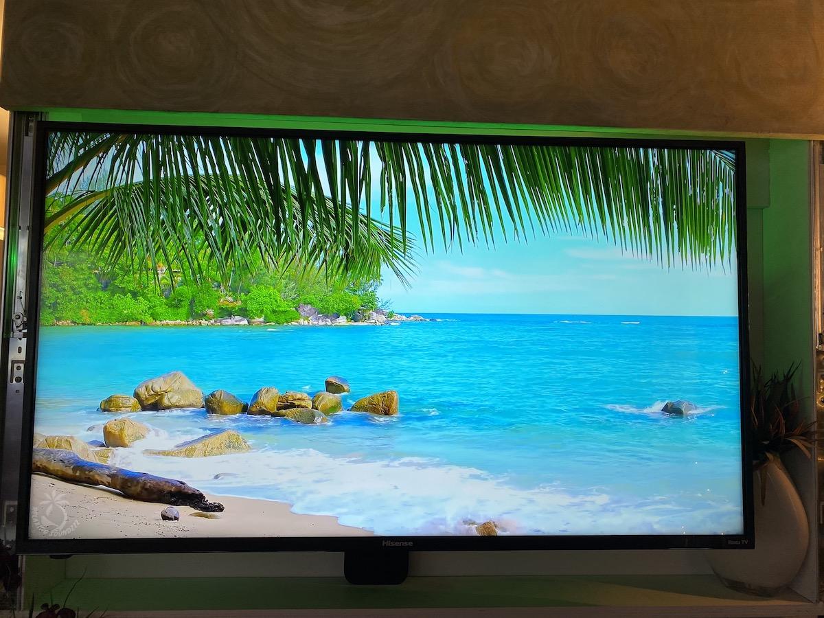LIFX Z TV light strip shining a green light behind the tv