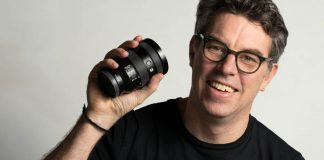 A photo of photographer Justin Morrison holding the Sony FE 24-105mm G OSS lens