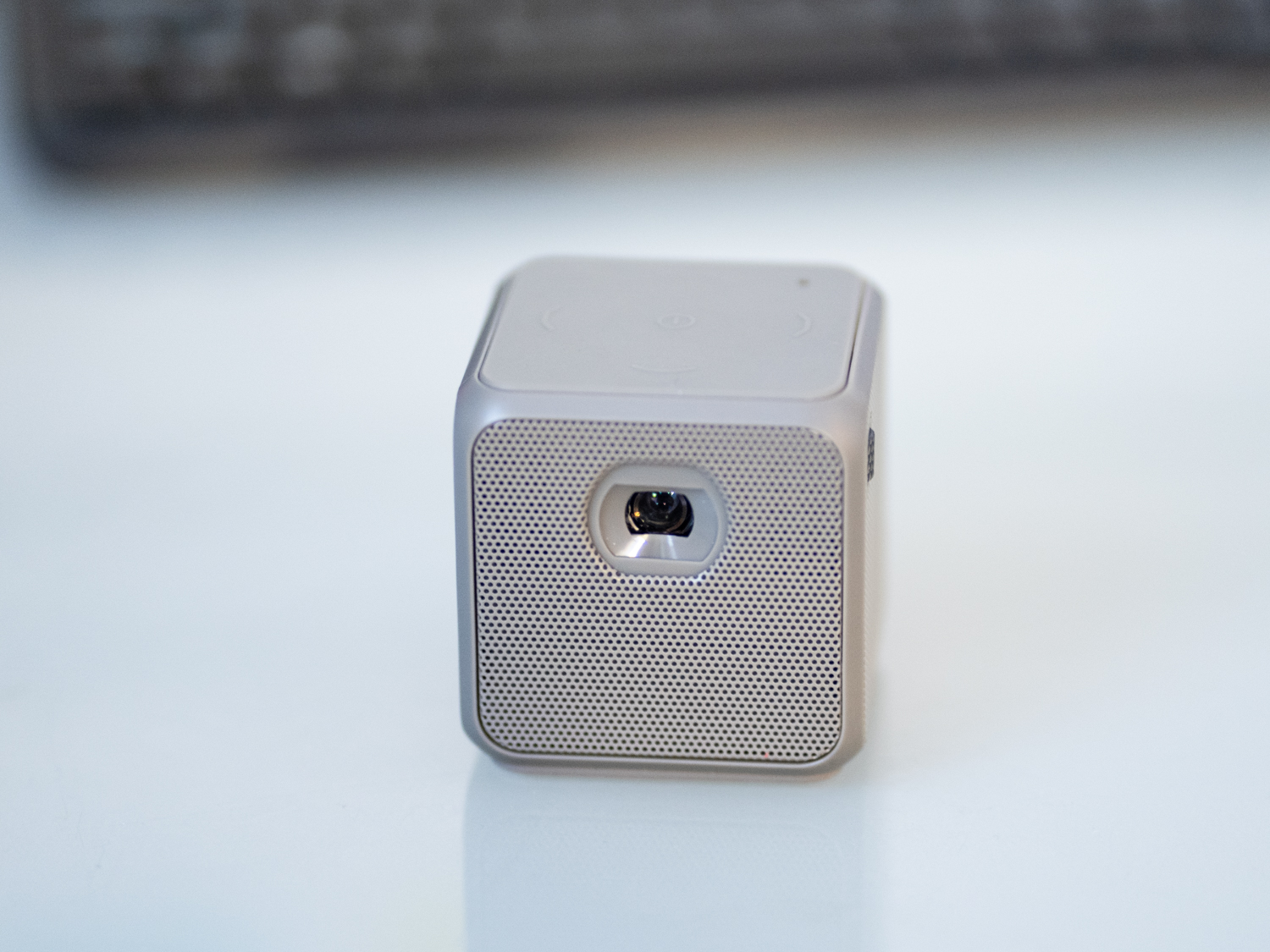 A photo of the front of the XPRIT smart cube projector