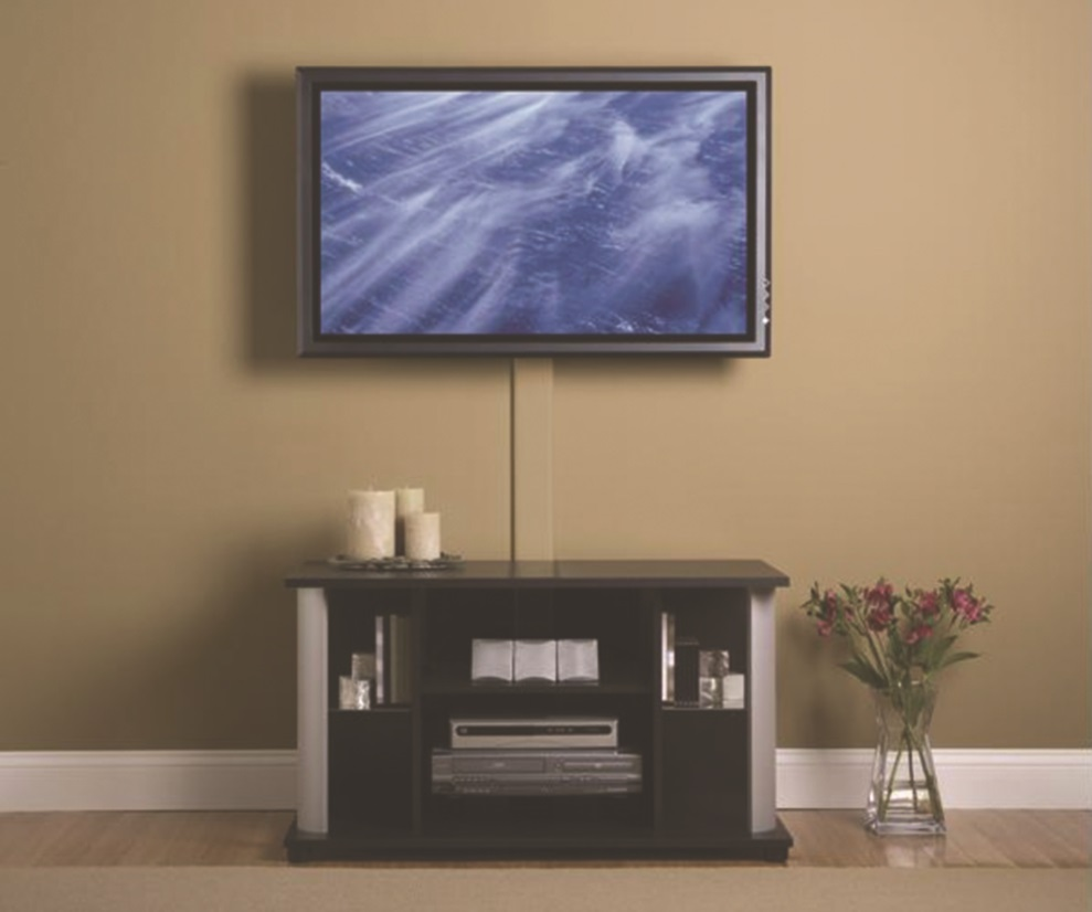 image of a mounted TV with a cable management system; the cables are gathered in a line down the wall and hidden behind a cover