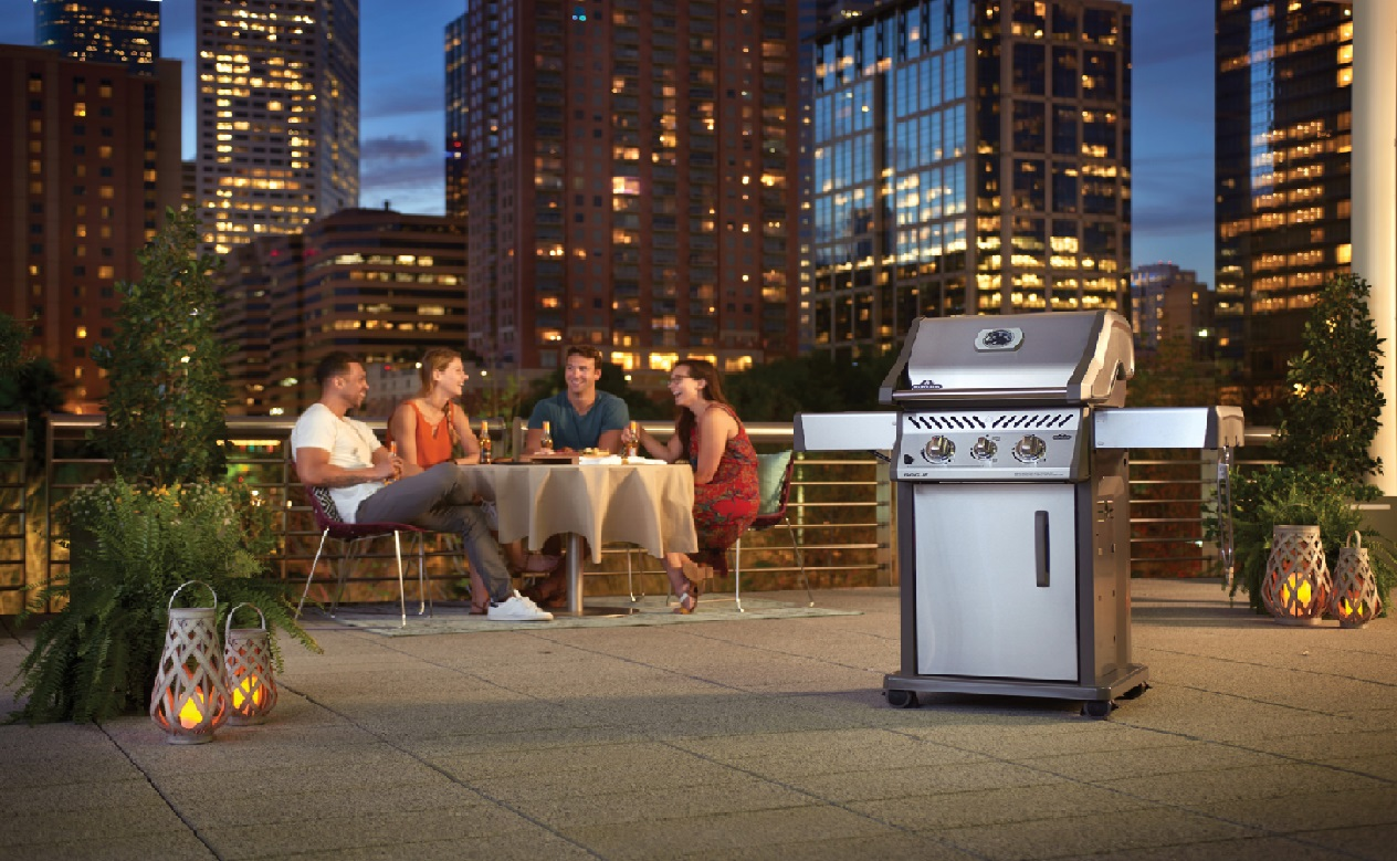 image of a rooftop BBQ party with a BBQ in the foreground