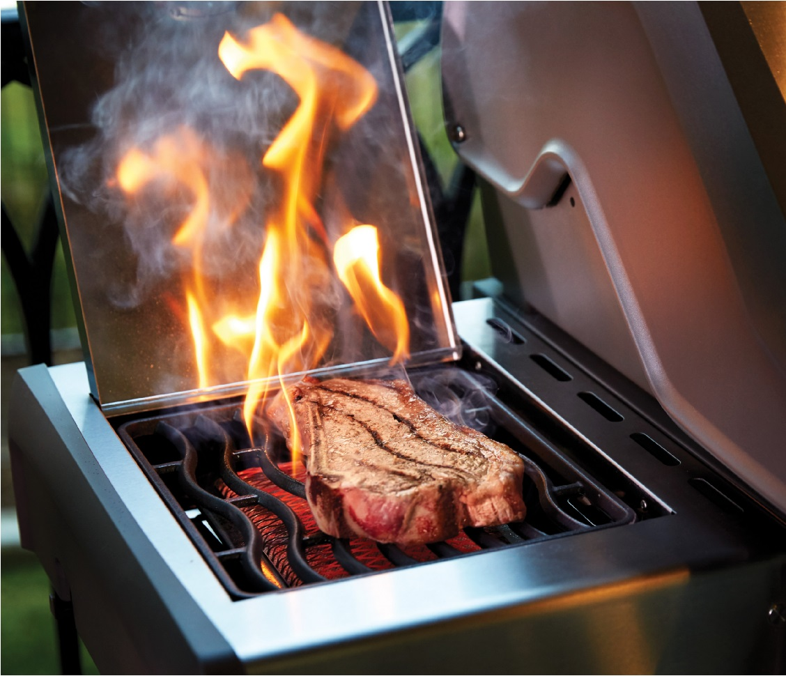 image of a side burner searing a steak with flames