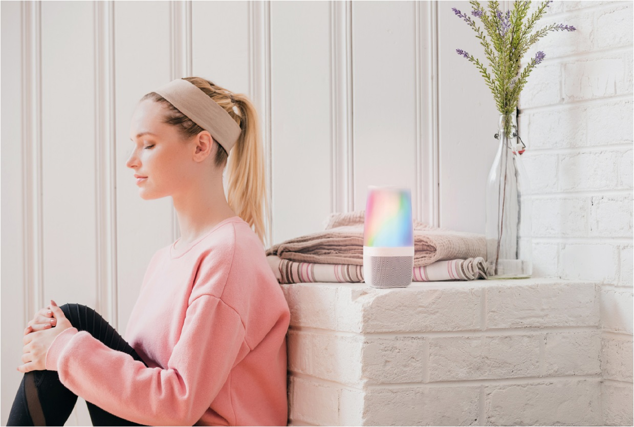 image of woman sitting next to an aromatherapy diffuser