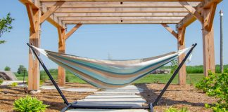 image of a free-standing hammock under an awning