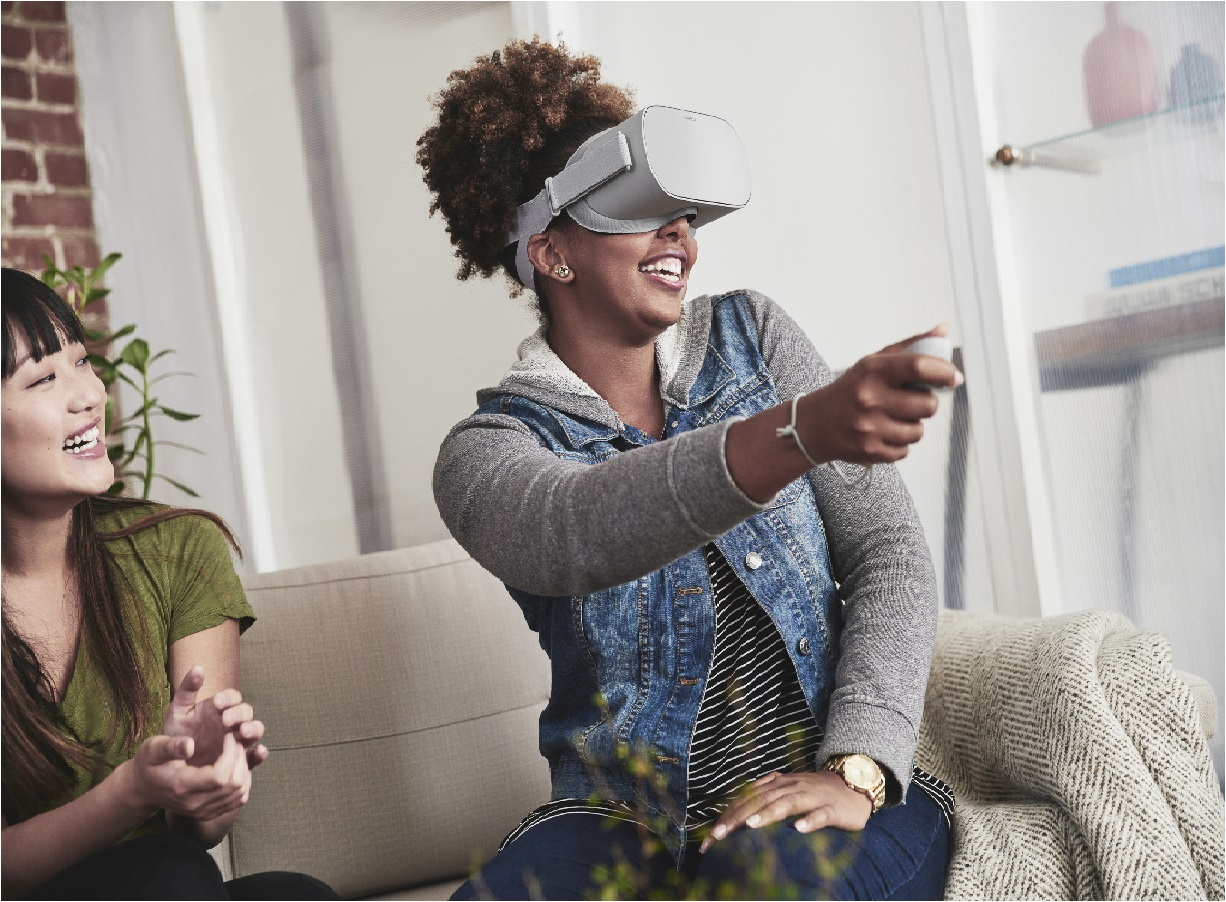 image of woman playing an Oculus VR game
