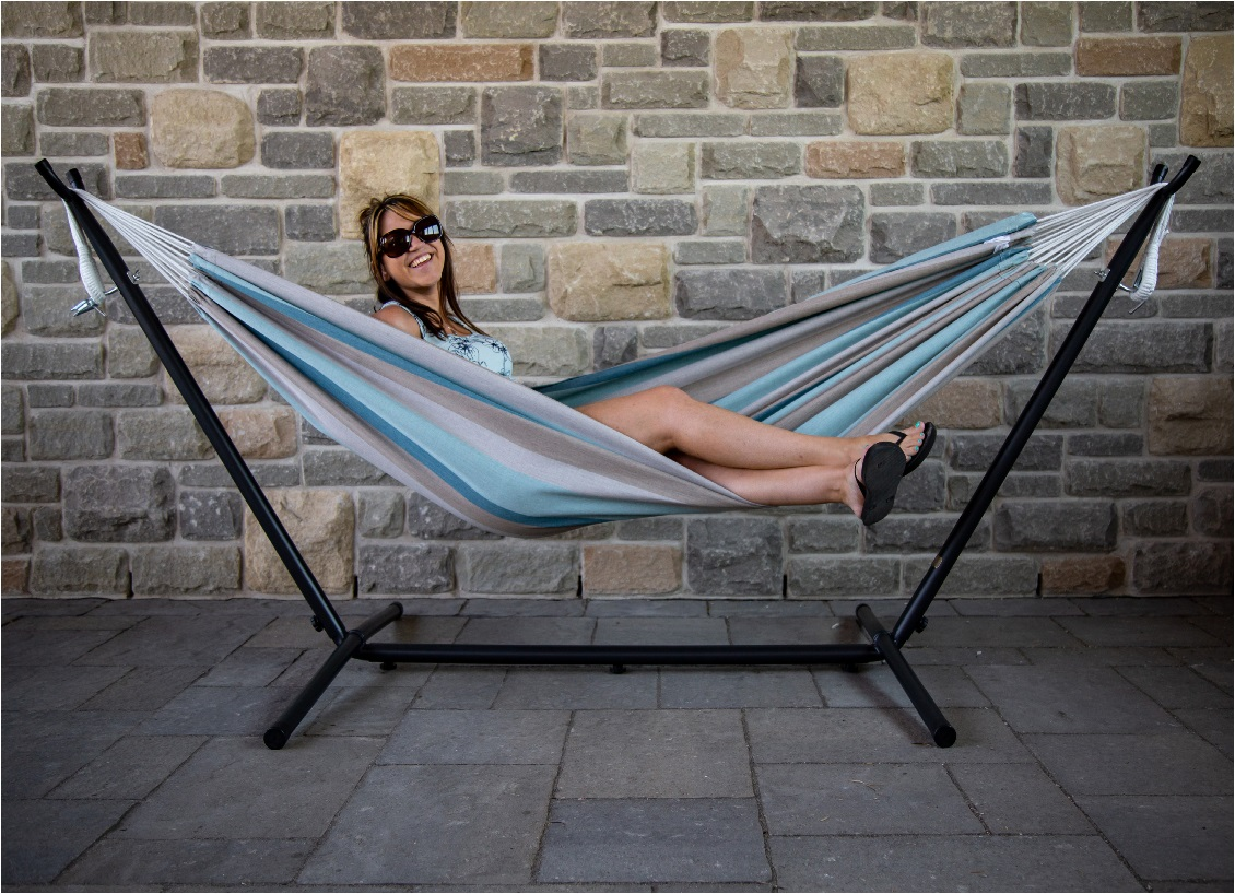 image of a woman lying down in a free-standing hammock