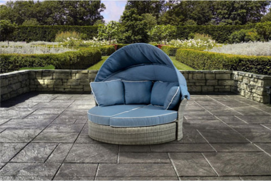 image of the Lioni Elba Outdoor Daybed on a patio with garden in background