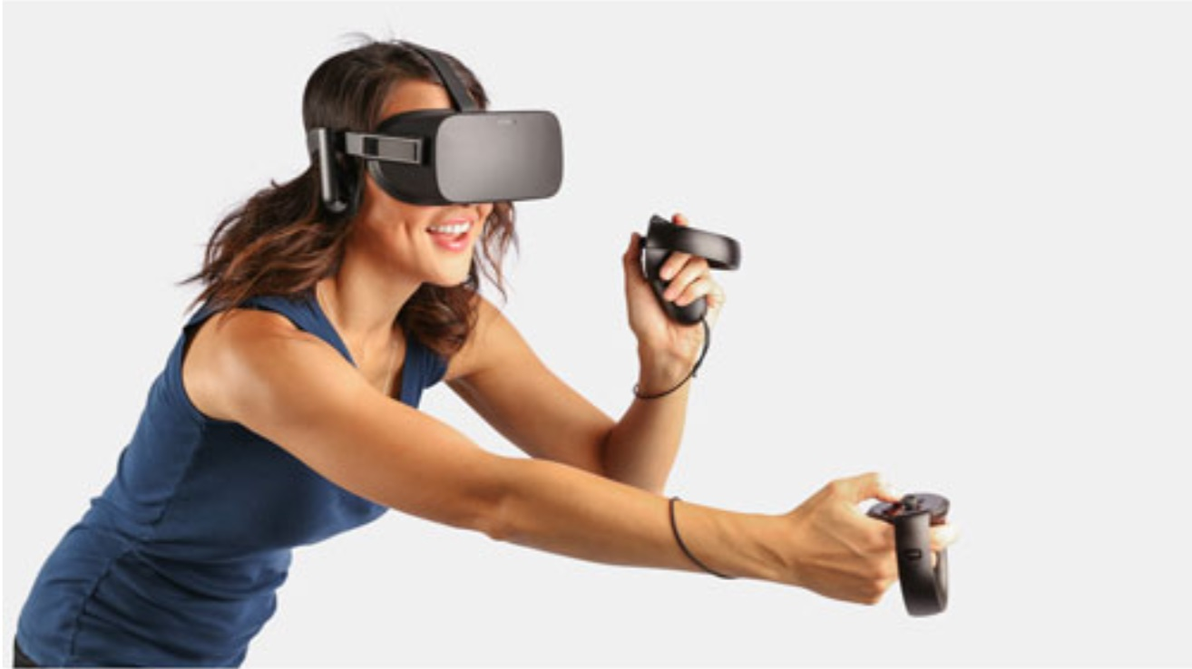 image of a woman wearing an Oculus headset and playing an Oculus VR game system