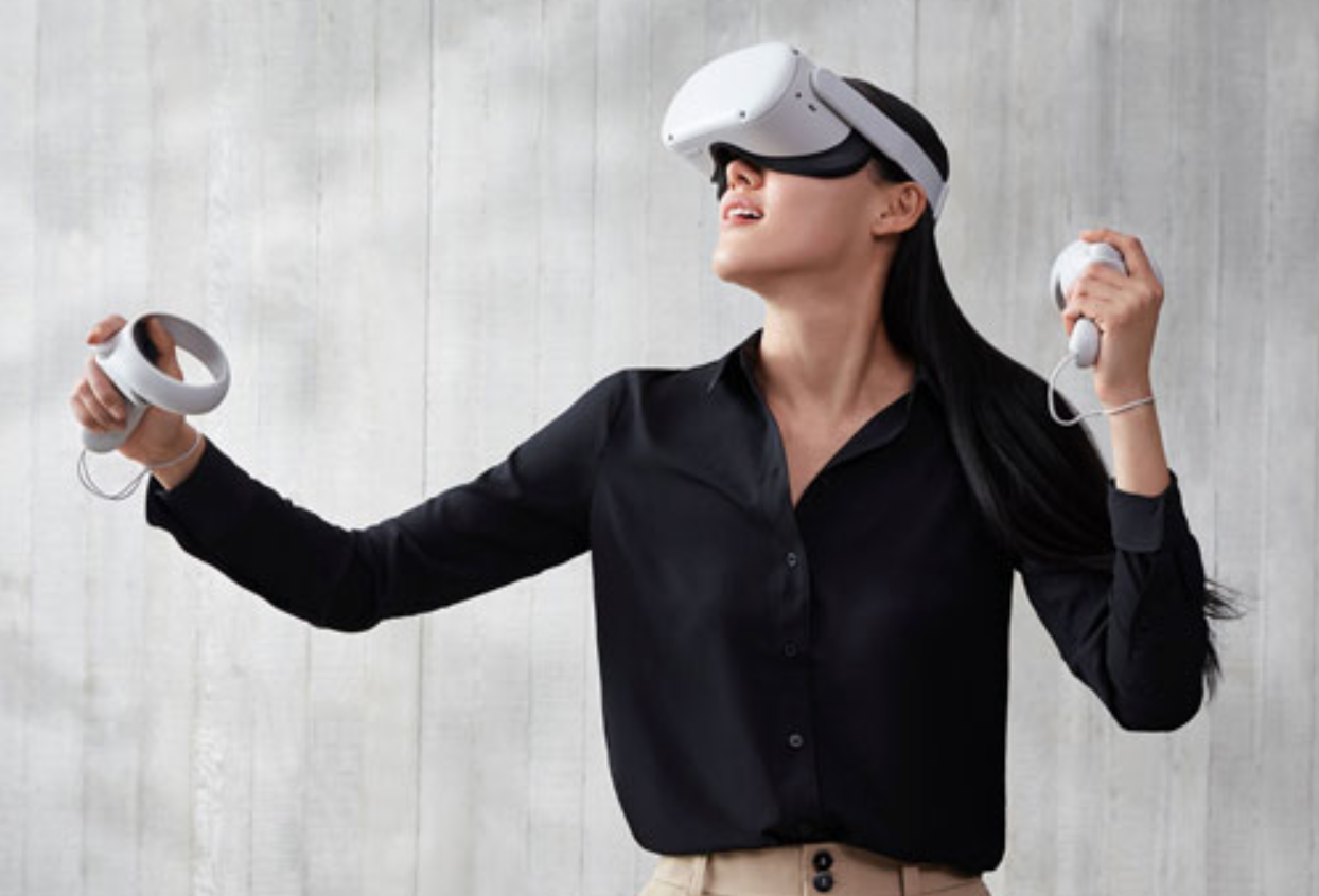 image of woman playing a VR game with the Oculus Quest 2 VR headseat