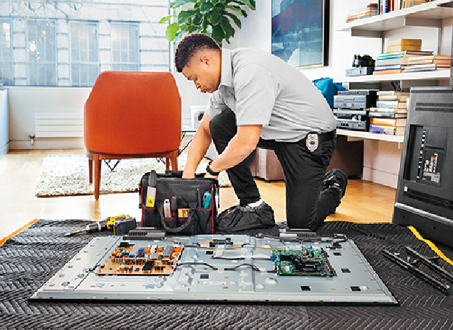 image of a Geek Squad Agent kneeling with a kit of tech tools