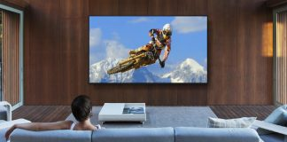 image of a woman on a sofa watching a mountain biker on smart TV