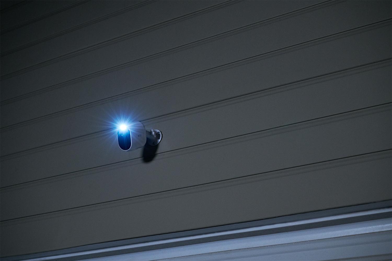spotlight on at night on the Arlo essential spotlight camera