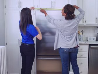 measuring the kitchen for a fridge