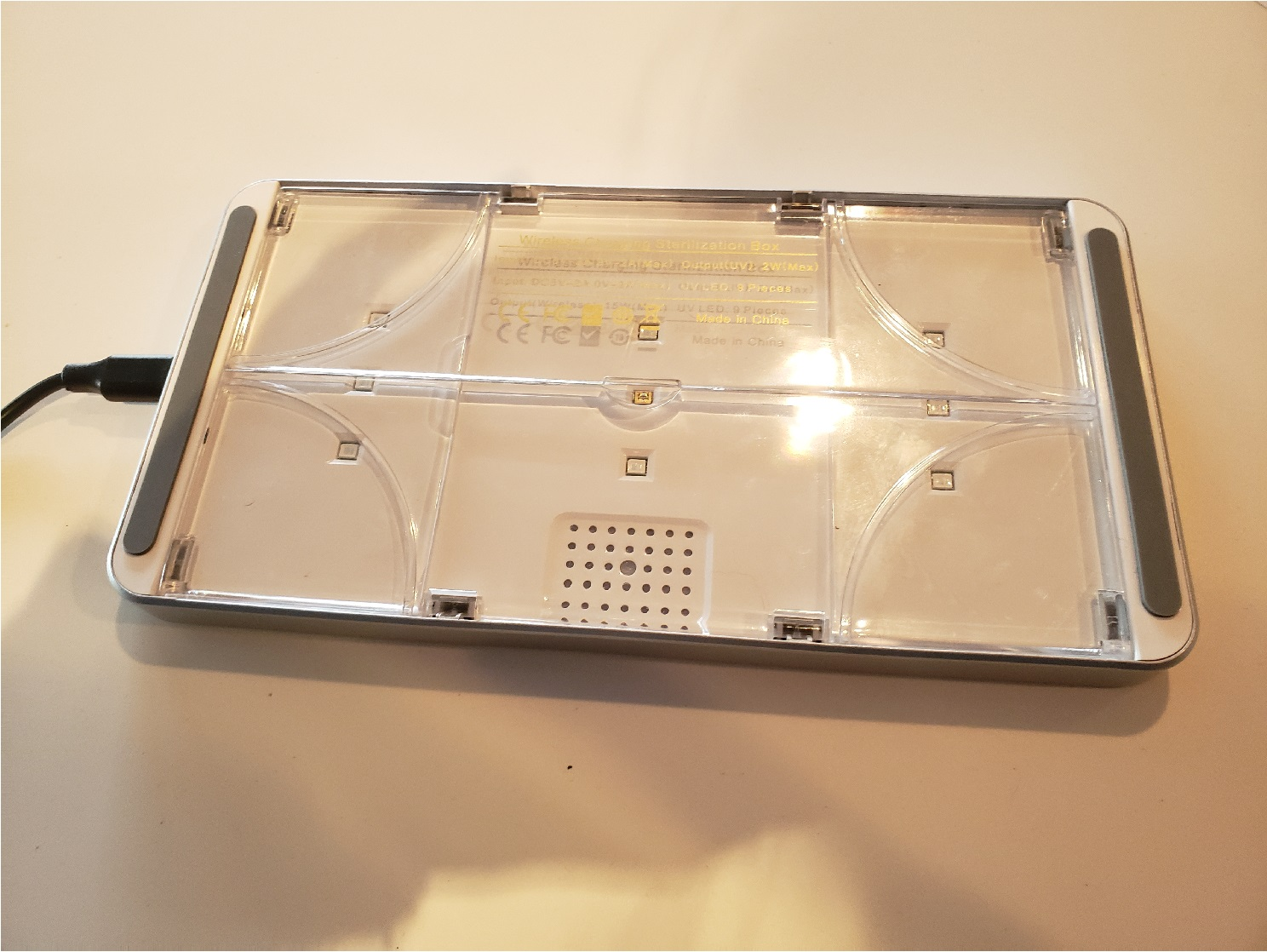 image of the underside of the UV sterilizer box with box sides collapsed