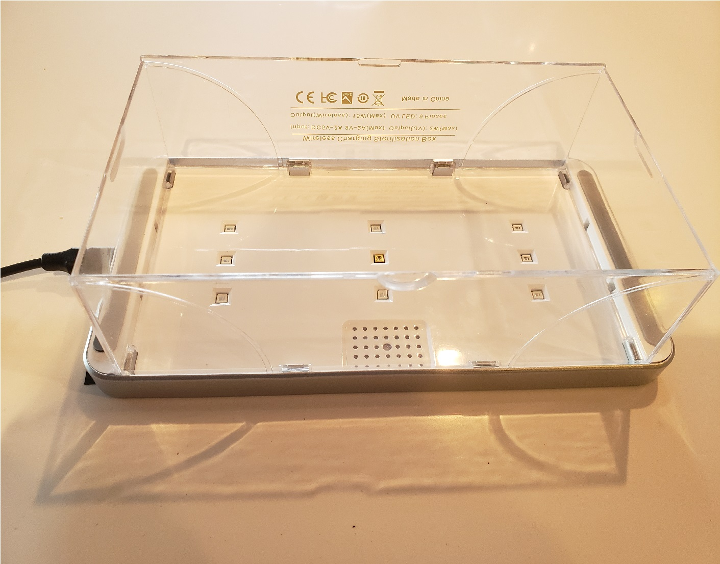 image of the underside of the UV sterilizer box with the box sides expanded