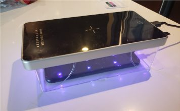 image of the UV sterilizer box placed over a phone and shining UV light on it