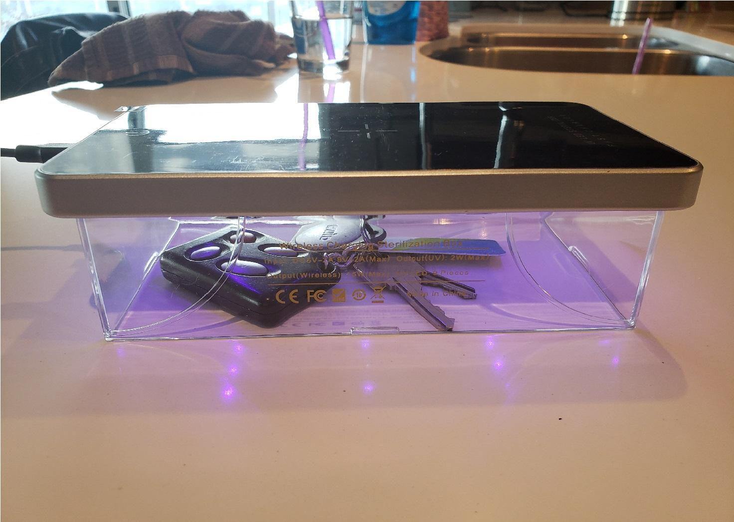 image of the UV sterilizer sanitizing a set of keys with UV light